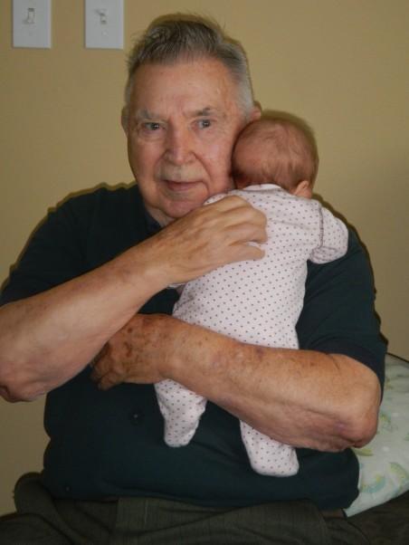 Grandpa George burping Ellie