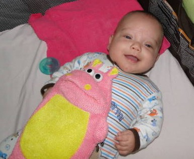 Theo loves his pinky hippo