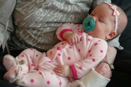 Baby Ellie is pretty in pink