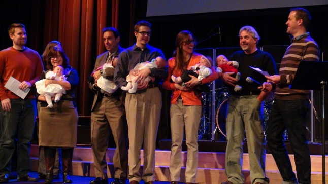 On stage with Grandpa Turzy, Grandpa Brett, Nana, their Godparents (Alex & Danielle) at Blackhawk Church's Child Dedication.